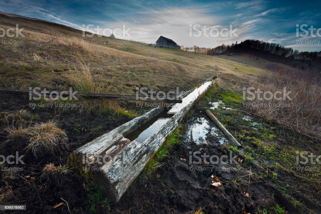 Watering trough in Beskids mountains stock photo