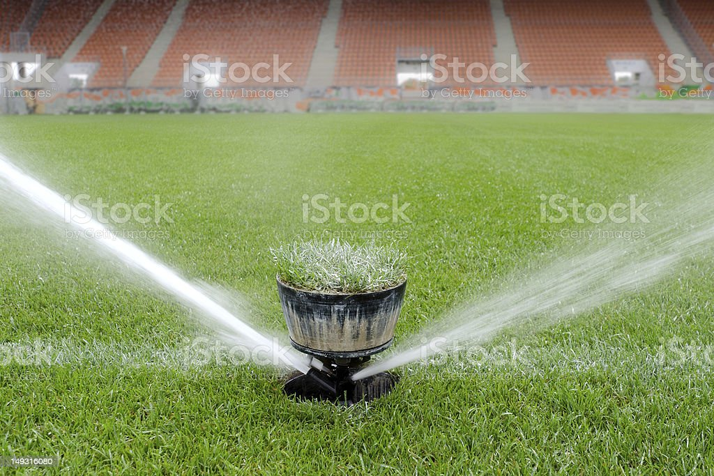 Watering turf stock photo