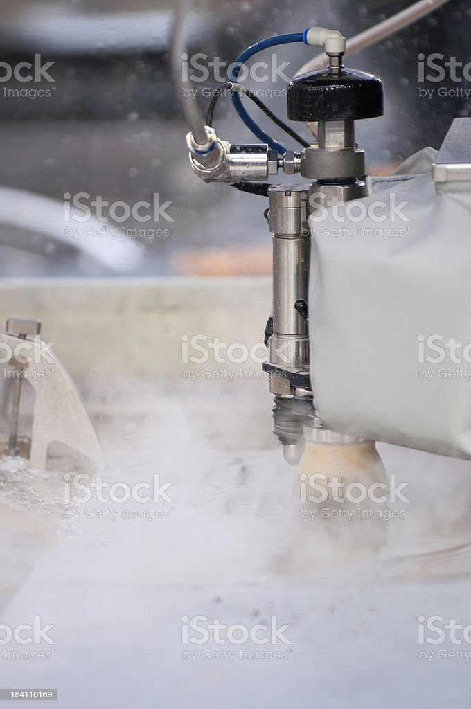 Waterjet metal cutter in action royalty-free stock photo