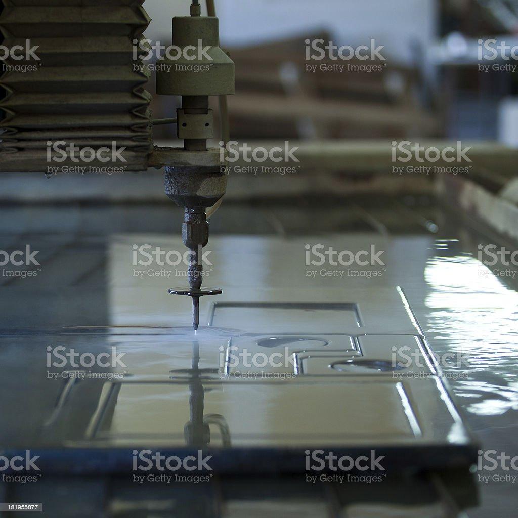 Waterjet metal cutter stock photo