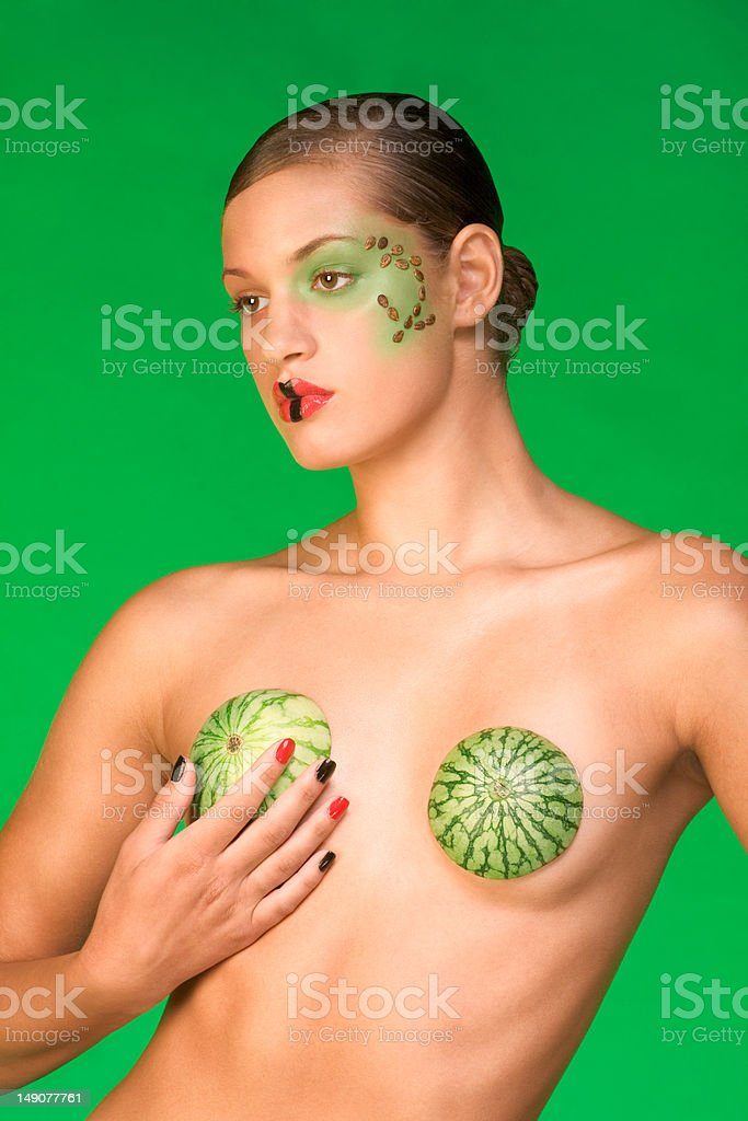 Watermelon beauty woman wearing unusual bra and exotic make up royalty-free stock photo