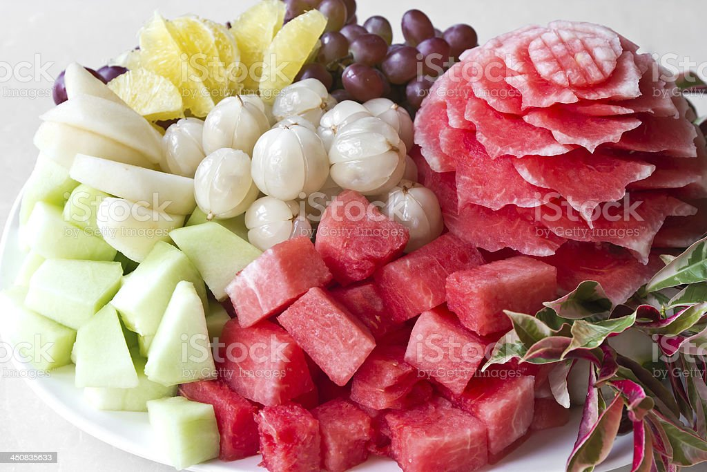 Watermelon carvings on a plate and famous fruits royalty-free stock photo