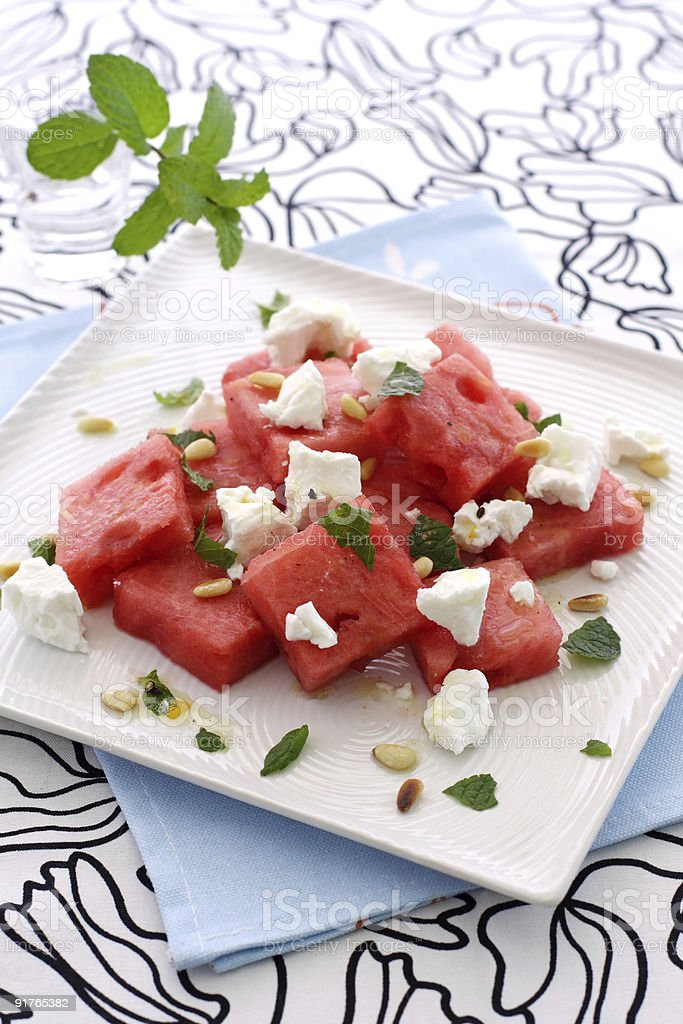 A watermelon feta salad on a square white plate royalty-free stock photo