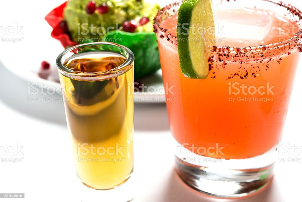 Watermelon Margarita, Tequila shot, and Guacamole stock photo