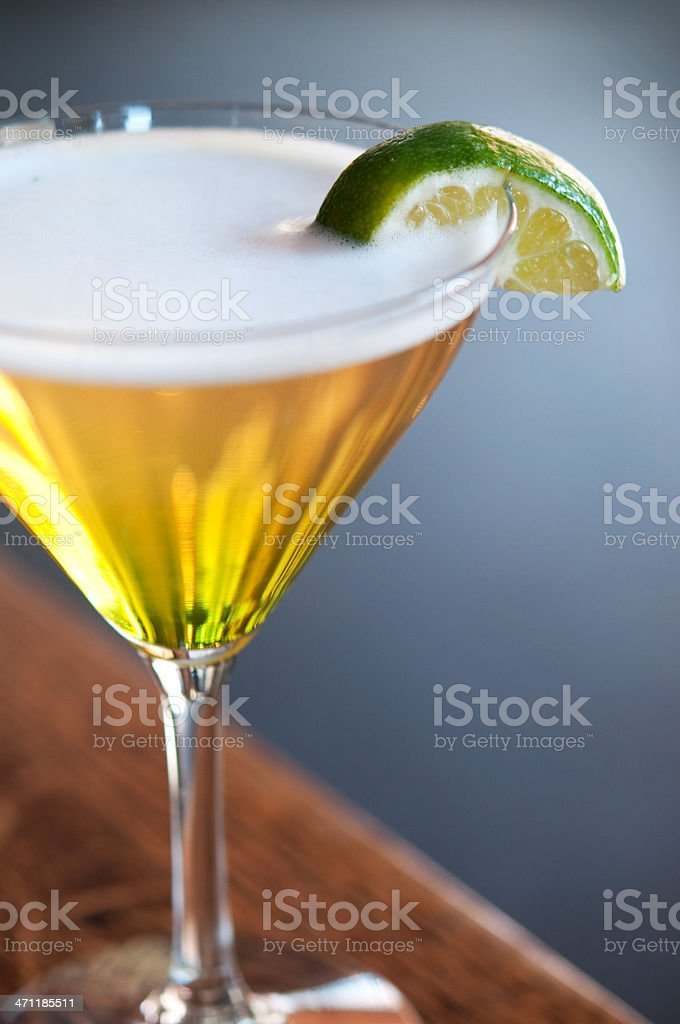 Watermelon martini garnished with lime wedge royalty-free stock photo