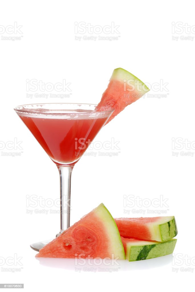 watermelon martini with slices of fruit stock photo