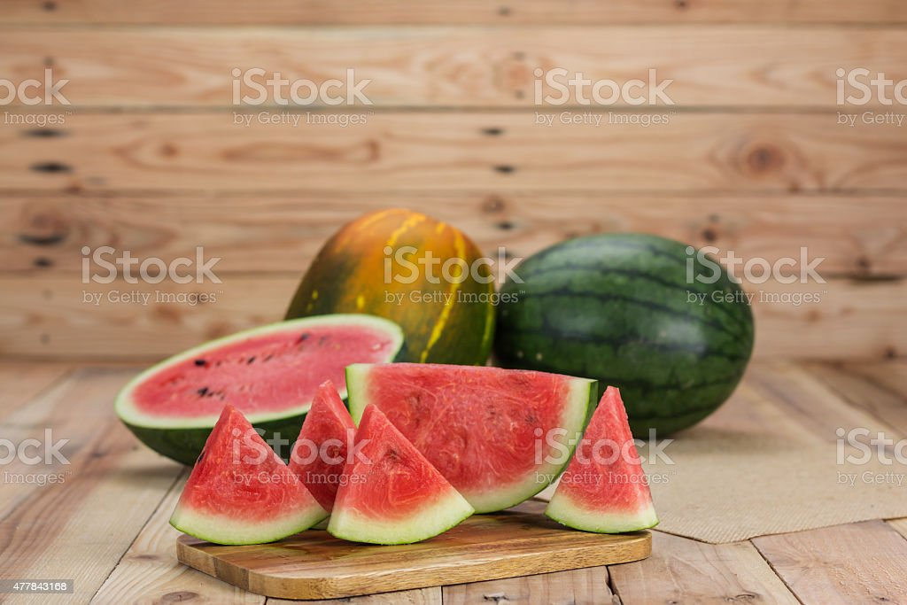 Watermelon on wooden background royalty-free stock photo
