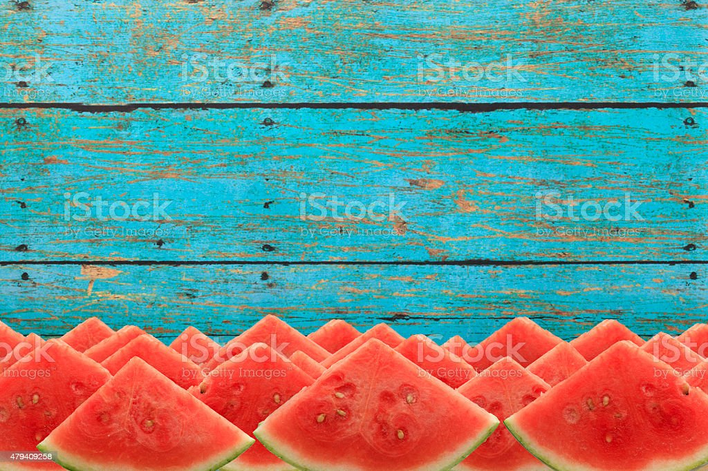 Watermelon Picnic Slices on Rustic Blue Table stock photo