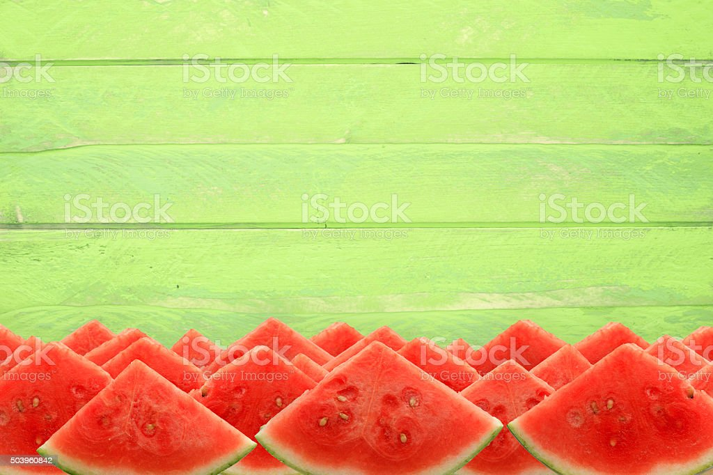Watermelon Picnic Slices on Rustic Green Table stock photo