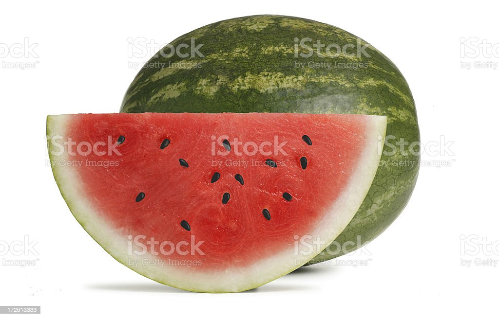 Watermelon slice in front of whole watermelon on white background stock photo