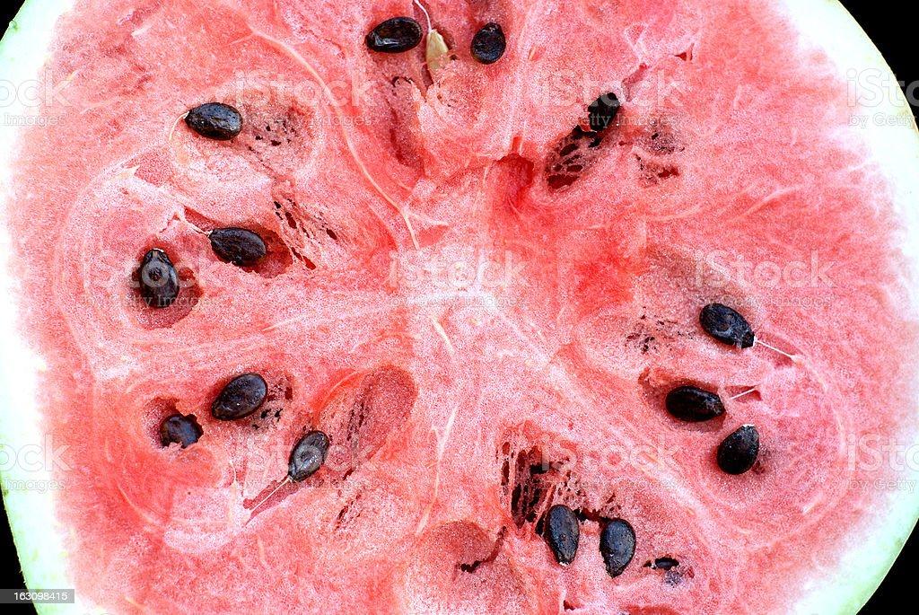 Watermelon slice many seeds closeup stock photo