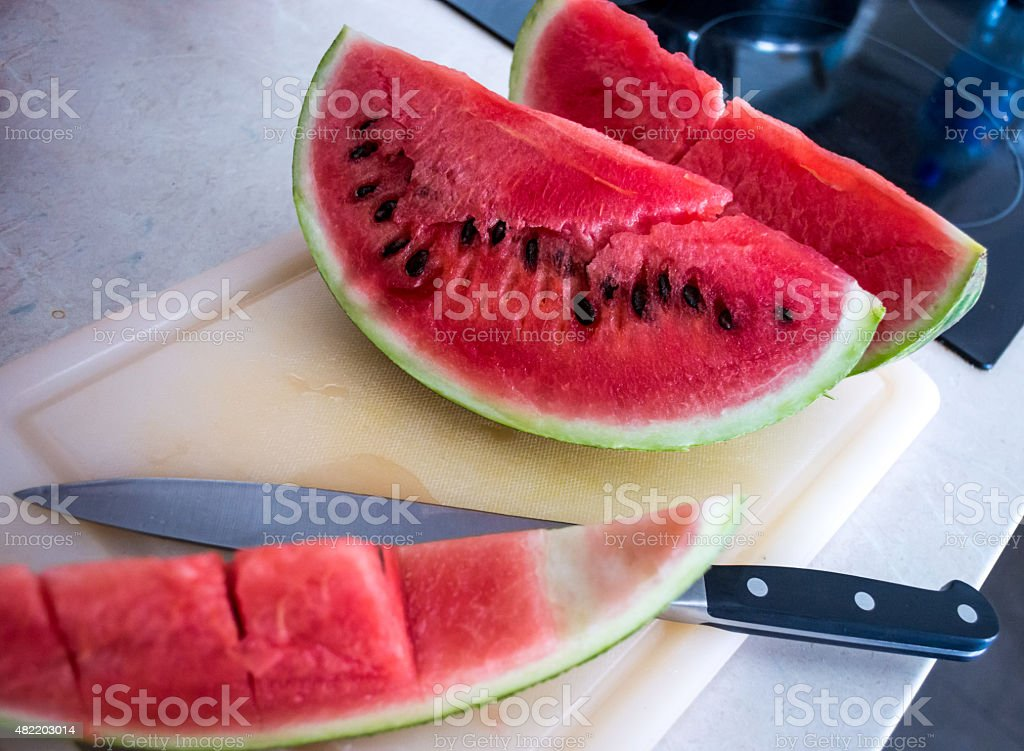 Watermelon Slices on Chopping Board with Knife royalty-free stock photo