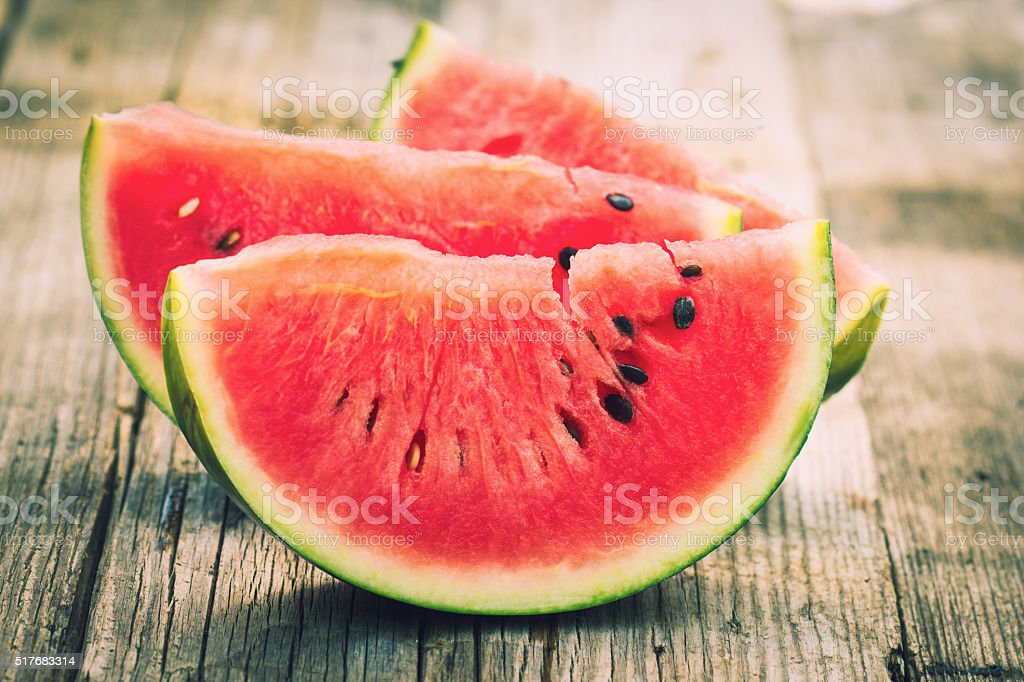 Watermelon slices on the wooden table stock photo