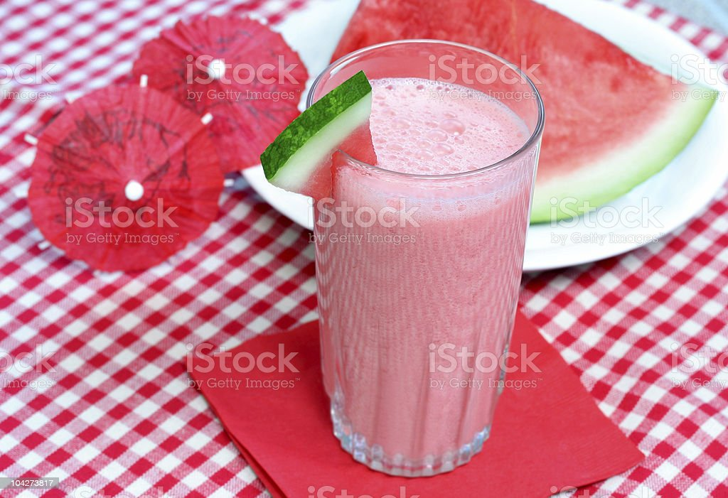 Watermelon smoothie on a red checkered tablecloth stock photo