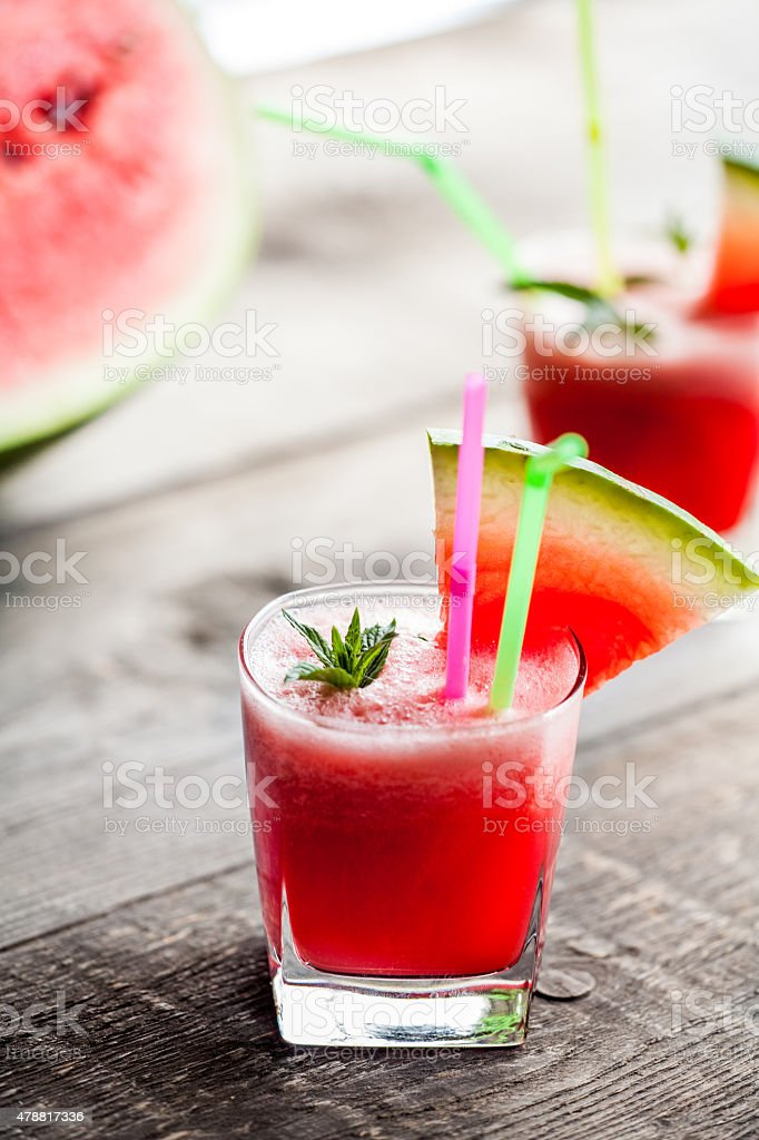Watermelon smoothie on a wooden table stock photo