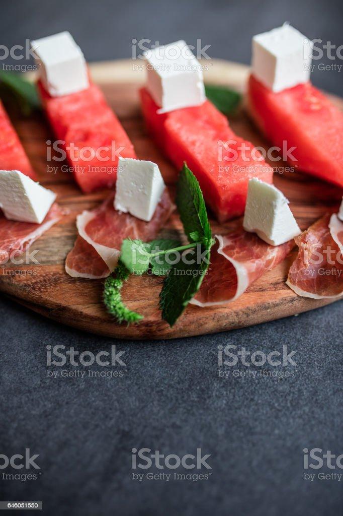 Watermelon with feta cheese stock photo