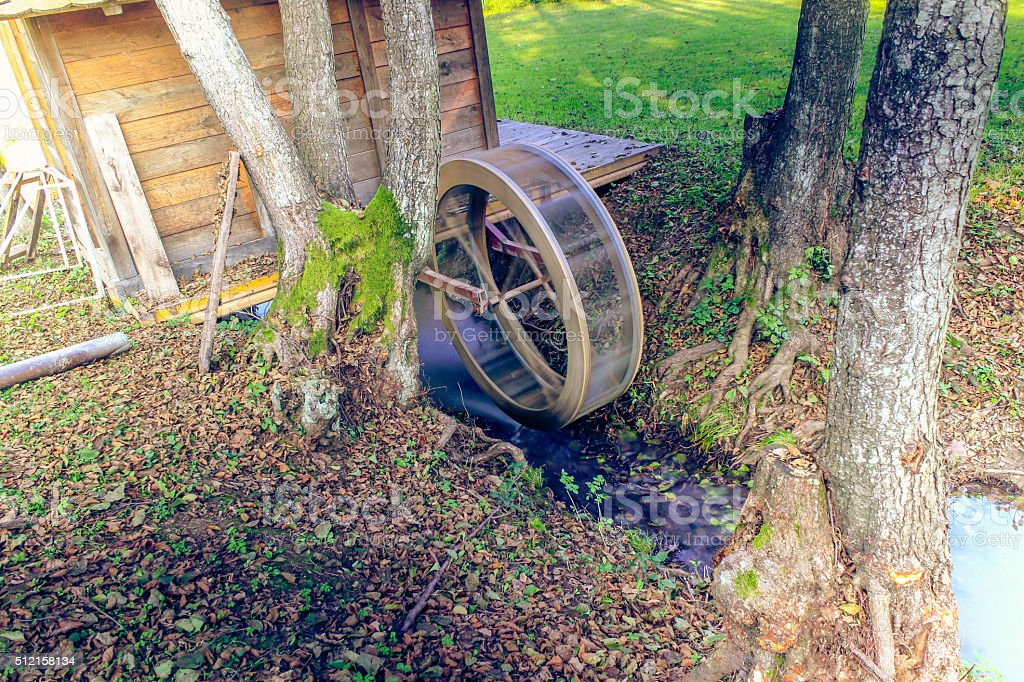 Watermill on the tiny river stock photo