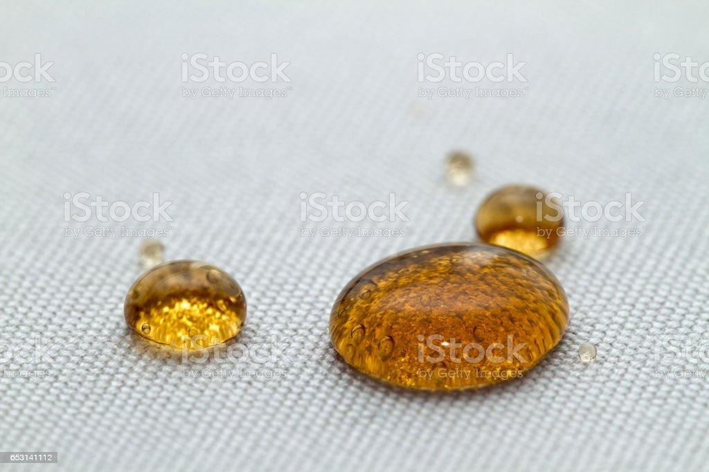 Waterproof coating background with coke drops stock photo