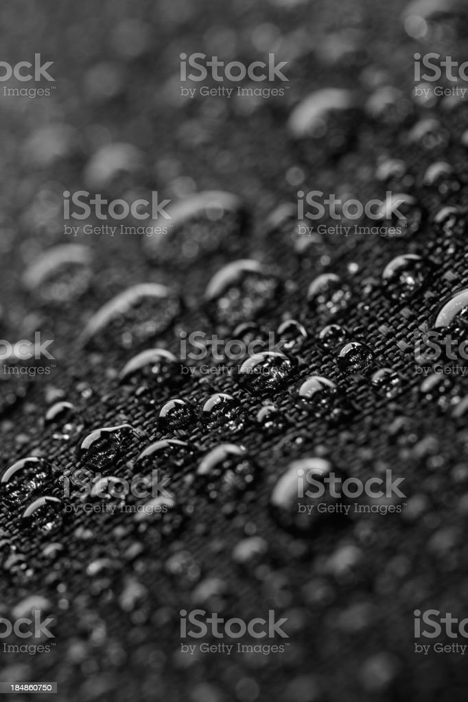Waterproof textile after rain - covered with water drops stock photo