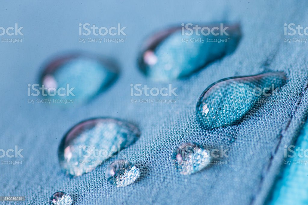 Waterproof textile repels water stock photo