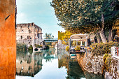 Waters and ancient buildings of Italian medieval village