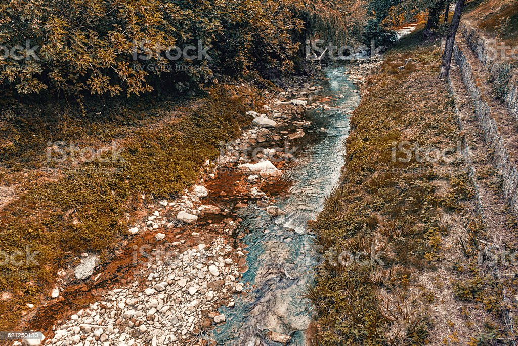 Waters bathing hill village stock photo