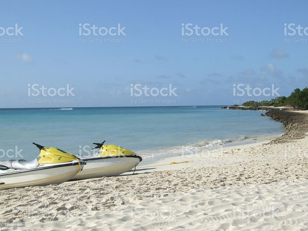 Waterscooters on a beach royalty-free stock photo