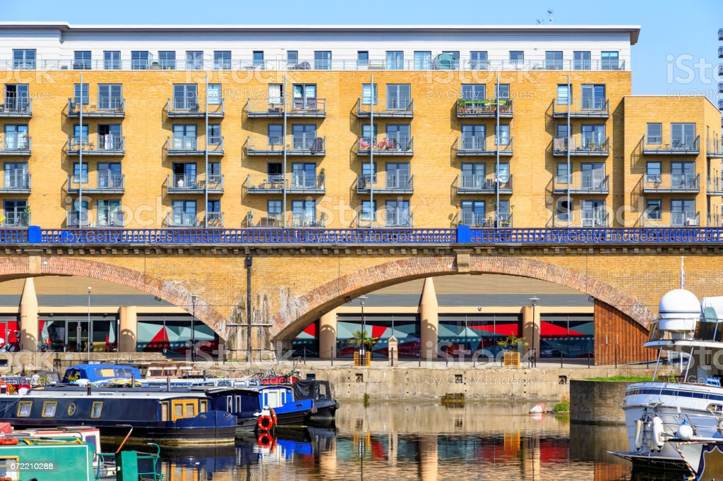 Waterside apartments and viaduct at Limehouse Basin Marina stock photo