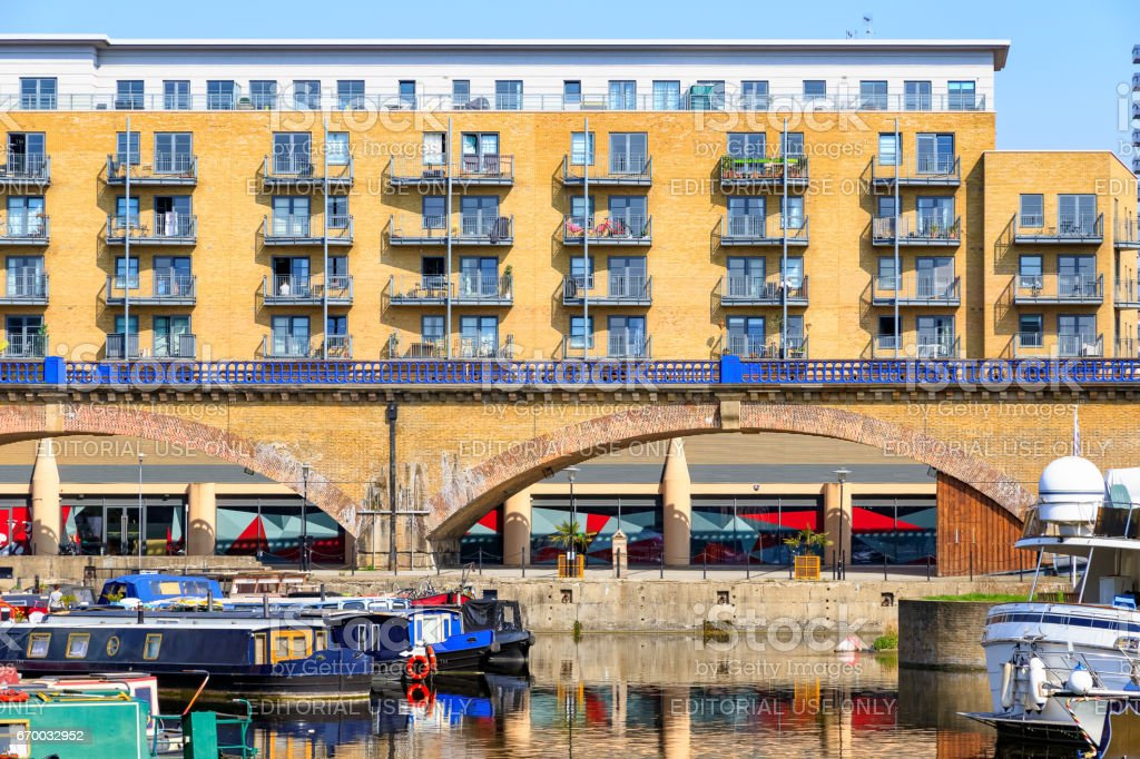 Waterside apartments and viaduct at Limehouse Basin stock photo