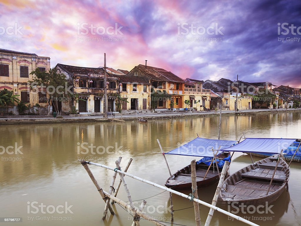 Waterside buildings and boats in old town, Hoi An, Thailand  royalty-free stock photo
