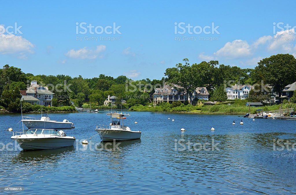Waterside homes & motor boats at inlet, Connnecticut, USA stock photo
