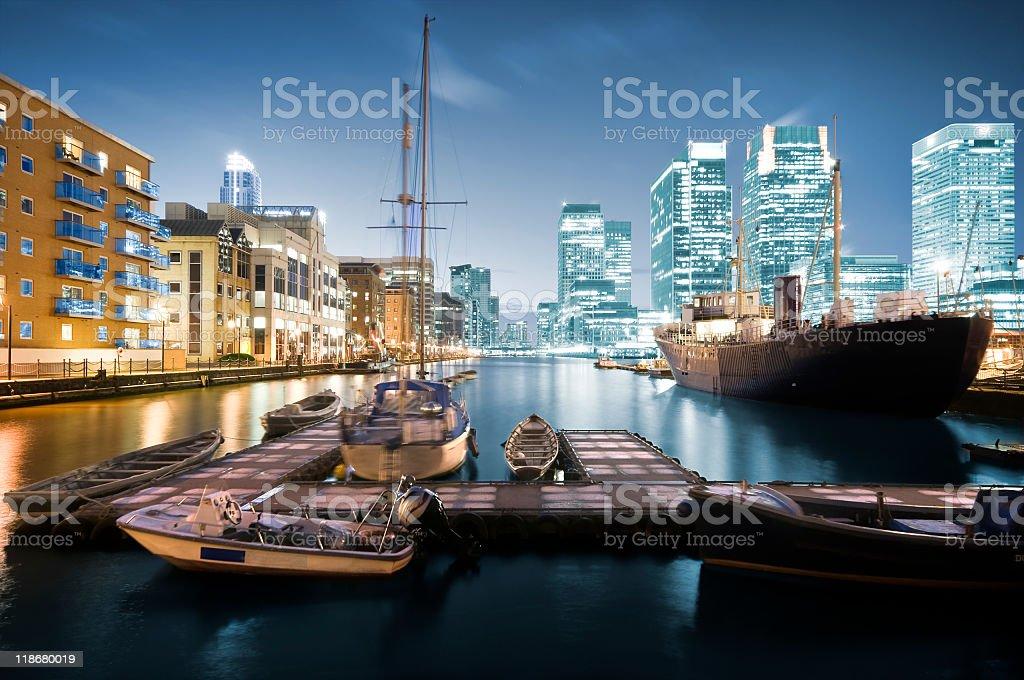 Waterside image of Canary Wharf at night, London, UK stock photo