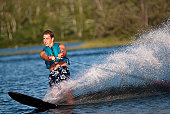 Waterskiing with man shredding waves