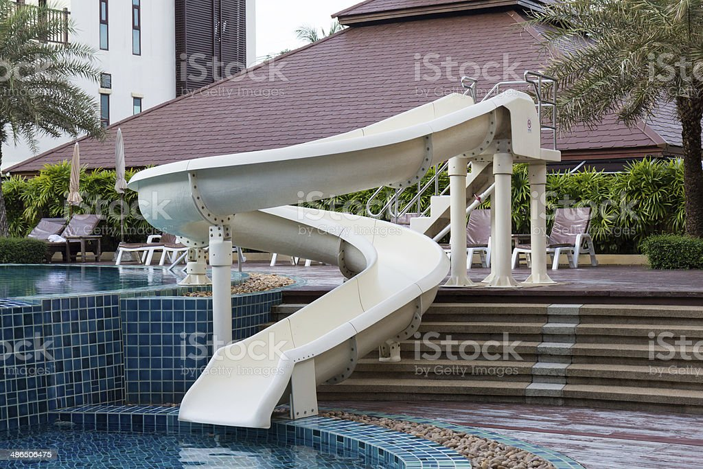 Waterslide near swimming pool royalty-free stock photo