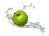 Water-splashed Granny Smith apple