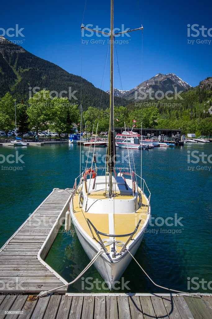 Waterton lakes national park sail boat on dock stock photo