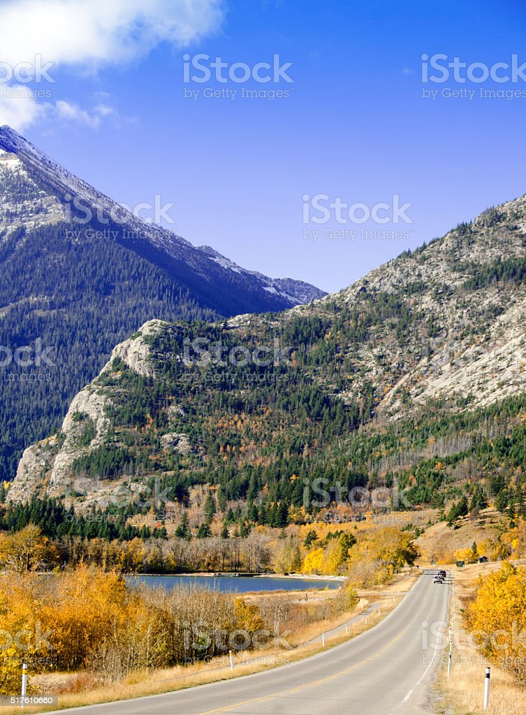 Waterton Park road to the town- autumn colorful yellow stock photo