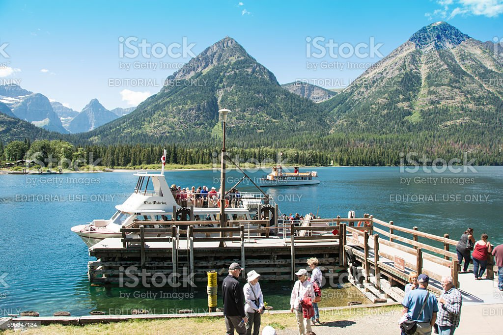 Waterton Tour Boats with Glacier National Park mountain background stock photo