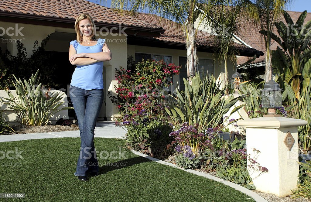 Waterwise Homeowner on Lawn stock photo