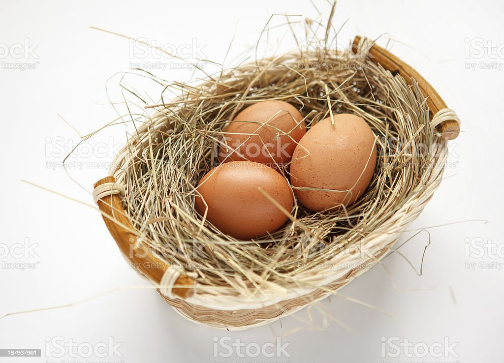Wattled willow basket with brown chicken eggs stock photo