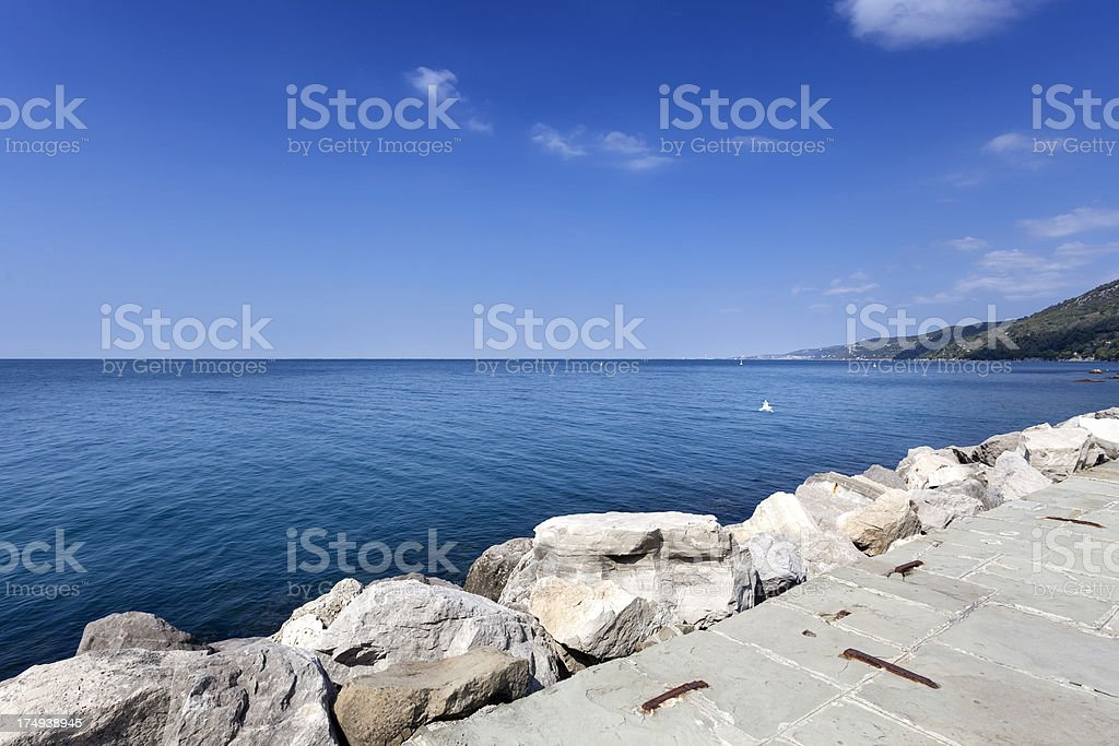 Wave breaker at the mediterranean sea royalty-free stock photo