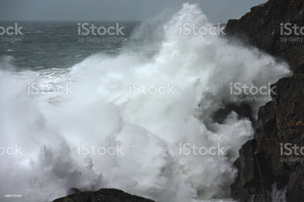 Wave breaking against cliffs at Pendeen Cornwall during storm royalty-free stock photo