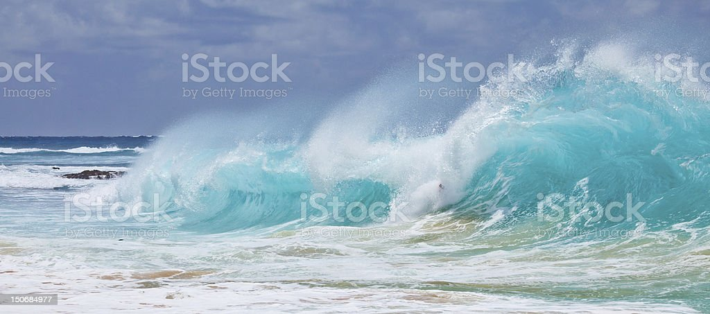 Wave breaking at Sandy Beach Park stock photo