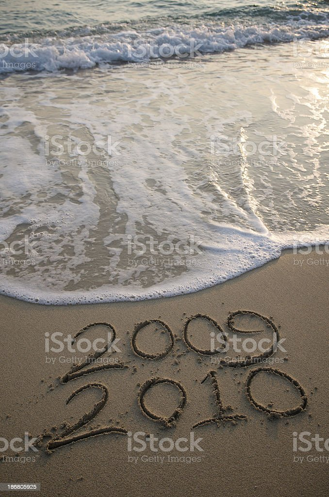 Wave Comes to Wipe Out 2009 Leaving 2010 stock photo