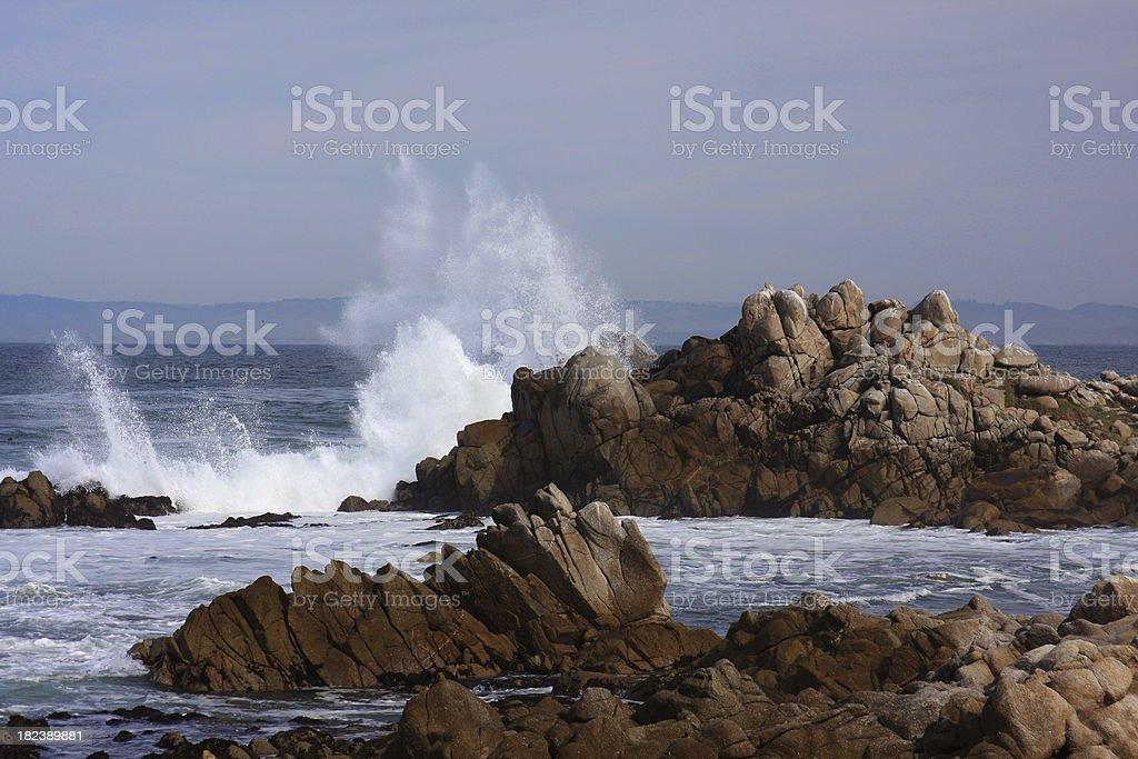 Wave crashes on the California coast stock photo