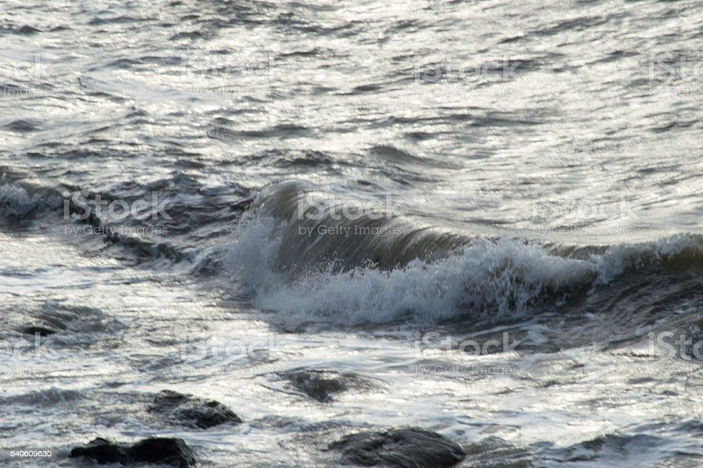 Wave Crashing Along The Shoreline stock photo