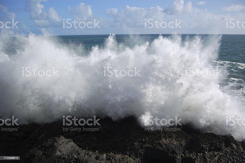 Wave Crashing into rock stock photo