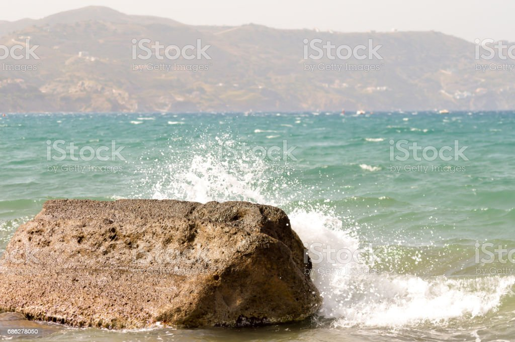 Wave crashing on a reef of the ocean stock photo