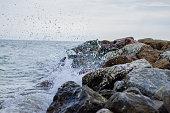 Wave crushing into a rock mole in Croatia