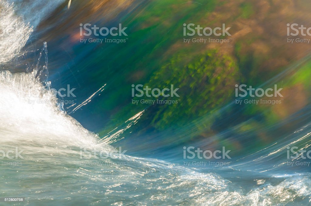 wave in a spring with algae - long exposure shot stock photo